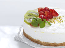 Cheese cake. A cheese cake decorated with stawberries and kiwies stock photography