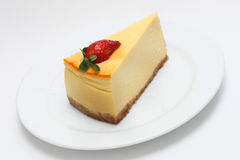 Cheese cake. With strawberry on a white plate Royalty Free Stock Photography