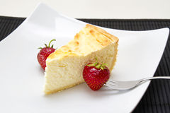 Cheese cake. With strawberries on plate Royalty Free Stock Image