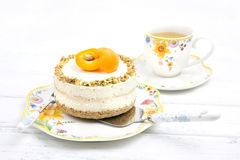 Cheese cake with apricots Stock Photos