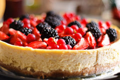 Cheese cake with berries. Cheese cake with blackberries, strawberries and red currant stock photo