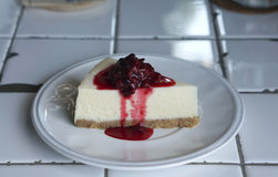 Cheese cake with berry jam Stock Photography