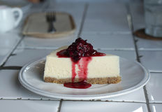 Cheese cake with berry jam Stock Photo