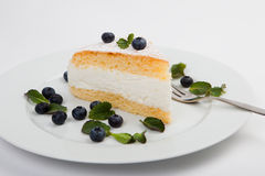 Cheese cake with blue berry and mint on white background Royalty Free Stock Image