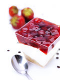 Cheese cake in a bowl with cherries. A close up of a cheese cake with whole cherries and sliced strawberries decorated with fresh strawberries and chocolate royalty free stock photos