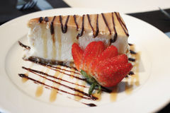 Cheese cake. With caramel and chocolate sauce Royalty Free Stock Images