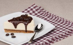 Cheese Cake With Chocolate Sauce On White Plate Royalty Free Stock Images