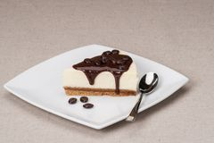 Cheese Cake With Chocolate Sauce On White Plate.  Royalty Free Stock Images