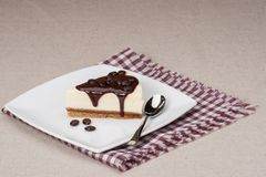 Cheese Cake With Chocolate Sauce On White Plate Royalty Free Stock Image