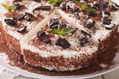 Cheese cake with chunks of chocolate cookies closeup. horizontal Stock Image