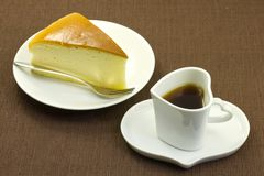 Cheese cake and coffee on the table Stock Image