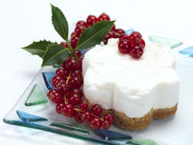 Cheese cake with cranberries. A flower shaped cheese cake with a christmas decoration stock photos