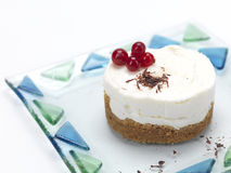 Cheese cake with cranberries and choco flakes. Cheese cake shaped as a flower ,decorated with cranberries,syrop and chocolate flakes stock images