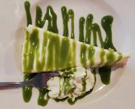 Cheese cake with cream and pistachio syrup. Pistachio cheese cake stock images