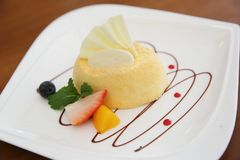 Cheese cake with fruits. On a plate royalty free stock images