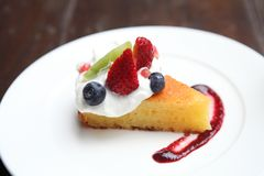 Cheese cake with fruits, Dessert. Cheese cake with fruits on a plate royalty free stock photo