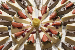 Cheese Cake Graphic. A geometric presentation of cheesecake topped with strawberries. Desert food for parties and events Stock Photos