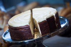 Cheese-cake with icing at cafe display Royalty Free Stock Images
