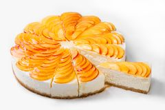 Cheese cake with peach slices isolated on white background. Bakery and pastry Royalty Free Stock Image