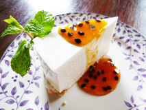 Cheese cake or pie with passion fruit sauce Royalty Free Stock Photos