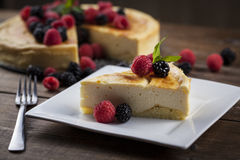 Cheese cake piece on a wooded table Royalty Free Stock Photography