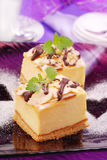 Cheese cake on purple plate Royalty Free Stock Photos