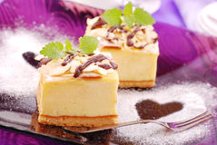 Cheese cake on purple plate Stock Images