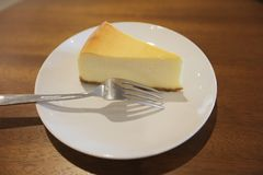 The cheese cake slice. At table Stock Photo