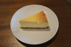 The cheese cake slice. At table Stock Images
