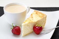 Cheese cake with strawberries. And coffee Stock Photo