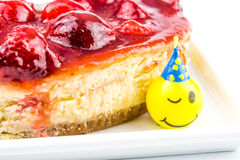 Cheese cake with strawberry and funny laughing candles Royalty Free Stock Photography