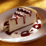 Cheese cake with strawberry sauce stock photography