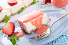 Cheese cake with strawberry sauce royalty free stock photography