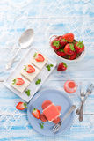 Cheese cake with strawberry sauce Royalty Free Stock Image