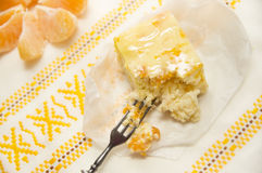 Cheese cake with tangerineson on rustic tablecloth Royalty Free Stock Images