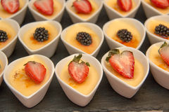 Cheese cake in white cup ontop fruit Royalty Free Stock Images