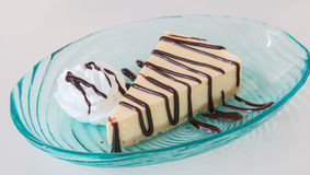 Cheese cake and wip cream with chocolate sauce Royalty Free Stock Photography