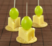 Cheese canape Stock Images