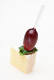 Cheese canape with grape and mint isolated. On white Stock Image