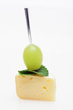 Cheese canape with grape and mint on white Royalty Free Stock Photo