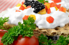 Cheese Canape Macro. Bright macro of cream cheese canape with chopped peppers, parsley and tomatoes Stock Image
