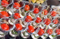 Cheese canapes with cherry tomatoes in the glass Stock Images