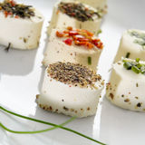 Cheese canapes. A plate with some different cheese canapes topped with different spices Stock Photography