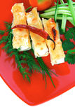 Cheese cannelloni on red Stock Image