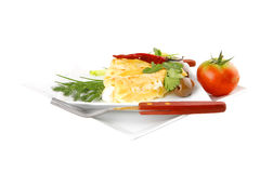 Cheese cannelloni on white plate Stock Image