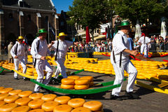 Cheese carriers at the traditional cheese market. Alkmaar, Netherlands - August 10, 2012: Cheese carriers at the traditional cheese market. Every friday morning royalty free stock photography