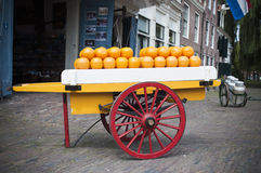 Cheese Cart. Cart in front of a market full of cheese Royalty Free Stock Photography