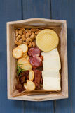 Cheese with cashew, smoked sausages Royalty Free Stock Image