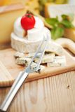 Cheese with a cheese knife Stock Photography