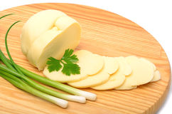 Cheese,cheese slices and green onion on the wooden board Stock Photos